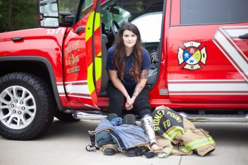 Katelind posing with her FireFighter gear